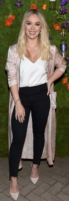 Who made  Hillary Duff's black skinny jeans and tan duster coat?