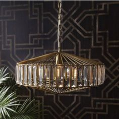 Bamboo Orbital Pendant Light : For a touch of glamour, the Babylon Ceiling Light from Modish Living is simply stunning. The light features a bronze metal cage with glass all the way around, perfect for catching the light. Art deco design at its best! Art Deco Pendant Light, Art Deco Chandelier, Art Deco Lighting, Pendant Lighting, Lighting Design, Chandelier Ideas, Ceiling Light Design, Art Deco Lamps, Retro Lighting