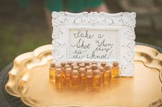 "Ceremony sign ""take a shot when they tie the knot!"" 