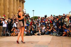Teaming her natural autographs design in a black and taupe mini dress, the stunning lady looked every inch for the loveliness while leading her French Open 2014 trophy through the eyes of public and much of the media.