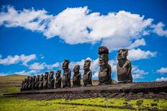 Easter Island in There are nearly 900 monumental statues called Moai, created by inhabitants during the centuries. The Moai are carved human figures with over sized heads, often resting on massive stone pedestals called Ahus. Easter Island Travel, Easter Island Statues, Samhain, Amazing Destinations, Travel Destinations, Historical Sites, World Heritage Sites, Lonely Planet, Cool Places To Visit