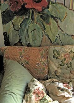 Very Bloomsbury. Original source not found. Love the primrose painting behind the sofa.