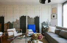 I luv the wall painting! ---- House Tour: A Brazil-Inspired Modern Mix in Switzerland | Apartment Therapy