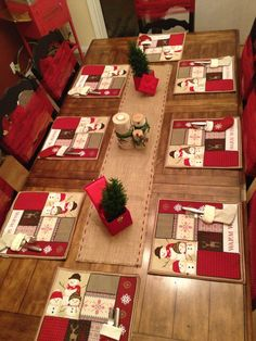 Tables all set for Christmas breakfast with a birch wood center piece, burlap runner, snowman place-mats, stocking utensil holder and a couple of live European Cypress trees.