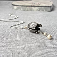 silver tulip necklace by gama | notonthehighstreet.com