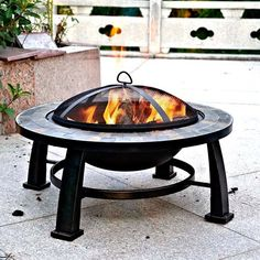 Round Slate Fire Pit Design Is an Ideal Outdoor Backyard Patio Fire Pit Table. Fire Pit Accesories, Mesh Cover, Wood Grate and Poker Are Included.