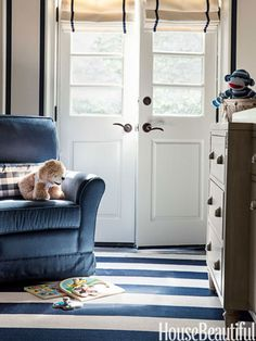 The son's room has a nautical flavor in neutrals with navy accents.