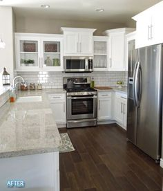 backsplash, couple open cabinets. Simple countertop on each side of sink (not really a possibility for us?) is nice. Stainless steel appliances give it a clean look. Not sure I like the recessed lighting though. Love shelf in front of window. A lot.: