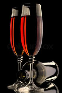 wine glass and bottle on the black background