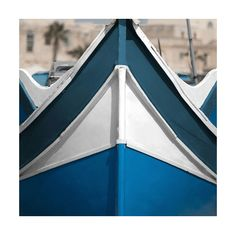 """TROWBRIDGE - Boat Bow IV - This photograph of a fishing boat's bow was captured in Marsaxlokk, Malta, where the ocean is as blue as the sky and the Mediterranean climate makes a day's hard work deserving of an afternoon siesta. The fishing vessel is painted in the classic and beautiful combination of blue and white. <p>Photographer: Nick Servian</p><p><a href=""""http://www.trowbridgegallery.com/catalogues/view-book.php""""><img src=""""http://www.trowbridgegallery.com/lib/img/BookBanner.jpg""""…"""
