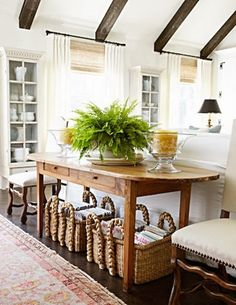 Nice mix of PB baskets, love the table setup and the white hutches in the back ground. The ceiling beams steal the show.