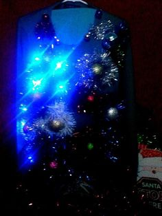 Check out this item in my Etsy shop https://www.etsy.com/listing/206262793/cosmic-christmas-light-up-ugly-christmas