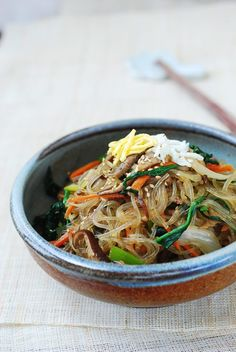 Made with bouncy sweet potato starch noodles, dangmyeon, japchae (or chapchae) is a classic Korean dish everyone loves! Find out how to make authentic, delicious japchae with this time tested, readers' favorite recipe! Korea Street Food, Thai Street Food, Korean Dishes, Korean Food, Japchae Recipe Korean, Stir Fry Glass Noodles, Rice Noodles, Vegetarian Recipes, Cooking Recipes