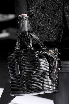 A beautiful ribbed black bag on the runway.