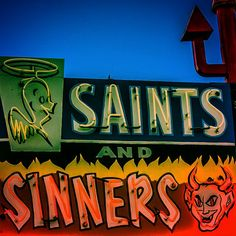 Saints and Sinners Liquors in Espanola, New Mexico. Twenty miles north of Santa Fe in the Espanola Valley you'll find the infamous liquor store. Family owned and operated for generations. [Neon Signage, Signs] #NerdMentor