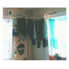Branch + string lights = adorable corner closet! #bedroom #storage #highceilingings #clothes #stringlights #diy #create #athome #tagallthethi...