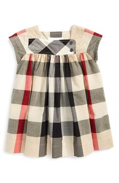 Free shipping and returns on Burberry 'Paisley' Check Print Dress (Baby Girls) at Nordstrom.com. Bright Burberry checks enliven a breezy cap-sleeve dress featuring a side button placket and flouncy pleated skirt.