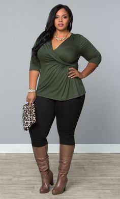 This is what you call style! We love the knee high boots with skinny pants and a tunic top.