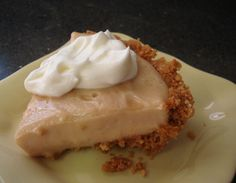 """PEANUT BUTTER PIE Makes 1 small 6"""" pie CRUST: 3 graham cracker sheets 2 ½ tablespoons unsalted butter, melted 2 tablespoons halved unsalted peanuts, toasted 2 teaspoons sugar pinch of salt For the pie: ⅓ cup sugar 1 tablespoon plus 1 ½ teaspoons corn starch ⅛ teaspoon salt 1 12-ounce can evaporated milk 1 egg yolk, lightly beaten ¼ cup creamy peanut butter ½ teaspoon vanilla Freshly whipped cream for serving, if desired"""