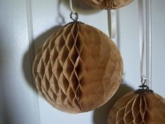 How to make the prettiest honeycomb paper balls ever ~ a tutorial from Donna Layton! I'd love to have these and with the silver tinsel pipe cleaner hangers they'd even be fabulous for my Christmas decor!