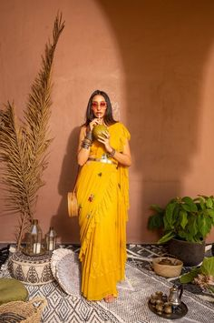 A tulle mango sari, with a lace ruffle hand embroidered in florals and herbs and gold planters and a mango lace bralette/crop. It comes with a mango skirt slip. Best indian fashion shop in New York Saree Styles, Blouse Styles, Blouse Designs, Indian Wedding Outfits, Indian Outfits, Ethnic Outfits, Indian Attire, Indian Wear, Indian Style