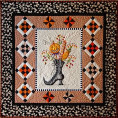 """This pattern is called """"Which Witch's Boot"""" and was completed in September Details are embroidered and colored with crayons. Tony used his artistic abilities and added more crayon color to the boot and pumpkins. Halloween Quilts, Halloween Artwork, Quilt Stitching, Applique Quilts, Embroidered Quilts, Quilting Projects, Quilting Designs, Sewing Projects, Quilting Tips"""