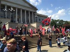 Klu Klux Klan members and supporters of the Confederate flag rally outside of the South Carolina statehouse. Craig Stanley...... People are crazy. Get with the times. There is no difference between us. #love