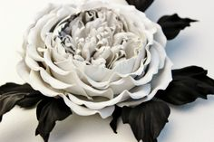 This white leather rose corsage is a part of our latest collection of black and white flower accessories called Le Cinematographe, Beautifully shaped rose blooms of David Austin that are packed full of frilly petals were the inspiration behind this leather rose piece of