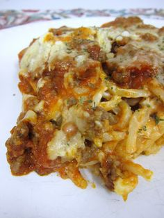 Baked Cream Cheese Spaghetti Casserole - the BEST baked spaghetti recipe! Spaghetti, garlic & cream cheese topped with a meat sauce and cheese. Beef Recipes, Italian Recipes, Cooking Recipes, Recipies, Cooking Tips, Italian Dishes, Sausage Recipes, Think Food, I Love Food