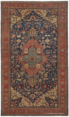 SERAPI, Northwest Persian, 11ft 0in x 18ft 8in, Circa 1875. This impressive oversize geometric carpet is an eminent example of the dynamic artistry achieved by the best of the Persian Serapi rug style. On a dramatic denim blue field, a deliberately spacious medallion creates a restful center amid a profusion of engaging stylized flowers and leaves that fill the extended field, each woven with individual character.