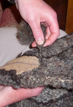 Making a Rug with Blue Texel Sheep Fleece: hooking fleece through hessian to make rugs