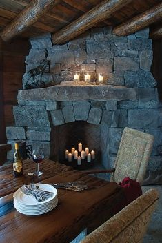 Stone Fireplace ... OMG ... 'n look, at the beams goin' thru ... I LOVE this concept, but I LOVE field stone, but I could suffer thru this for now lol