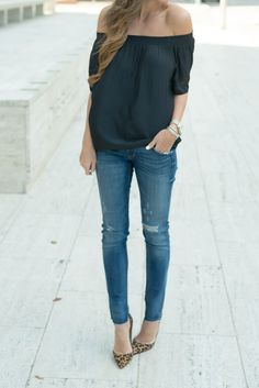off the shoulder black top, distressed denim, leopard pumps