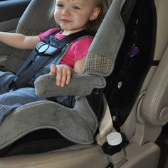 Baby Sitting In Car Seat With Buckle Guard PRO Attached Buckleguardpro