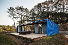 OZ House is a tiny home and summer getaway outside São Paulo, Brazil by Andrade Morettin Arquitetos Associados.