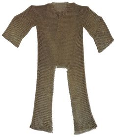Sudanese horseman's long-sleeved butted mail tunic. It has a slit front and back to allow the wearer to sit on a horse. The scoop neck joins to a vertical slit on the front so it can be pulled over the head. This armor was first worn in around the time the Turkish rulers of Egypt conquered Sudan. It was later reused by the Mahdists, followers of Muhammad Ahmad, who overthrew the Turco-Egyptian administration in 1885 and remained in power until 1898.