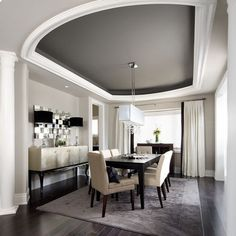 ceiling, wow. love that they took the wall color up onto the ceiling but then painted the tray darker. Yum