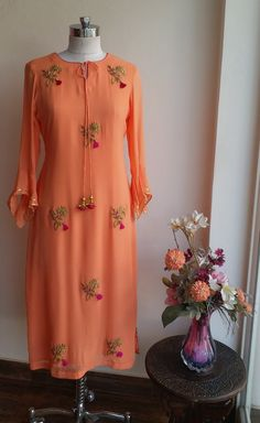 Peach Georgette Tunic with Zardozi bootas and Front neck Tie-up Kurti Embroidery Design, Embroidery Suits, Embroidery Motifs, Embroidery Works, Salwar Designs, Kurti Designs Party Wear, Kurti Patterns, Dress Patterns, Sewing Patterns
