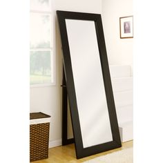 Step outside with confidence with Emilia's black full body mirror. Its elegant, sleek design makes this mirror a subtle, stylish accessory to any room. Clean, modern design with black finish. Wood frame material. No assembly required.