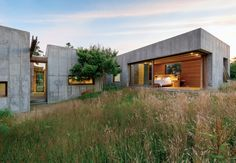 Despite being set in concrete, an idyllic modular retreat is built to go with the flow.