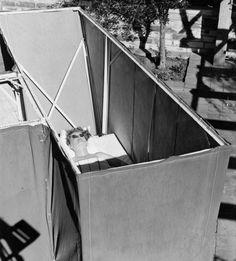 Bette Davis sunbathing in the back garden of her Beverly Hills home, 1939