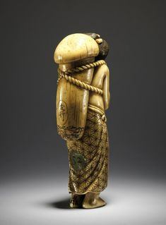 Netsuke. Woman with phallic mushroom. Made of ivory. Producer nameMade by: Tomoyuki Production placeMade in: Japan Trustees of the British Museum
