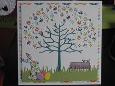 """I love the use of punches as """"leaves"""" on the tree that show the colors inside the card or I this case the colorful patterned paper underneath the top layer."""