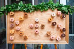 DIY donut wall - made by the groom - Donuts from Dat Donut Chicago Chicago wedding planner Staceylynndesign.com