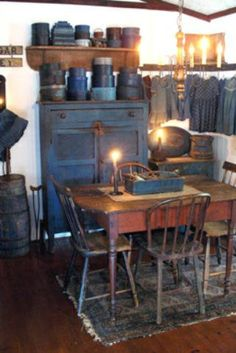 Primitive dining room with lots of lovely early blue.