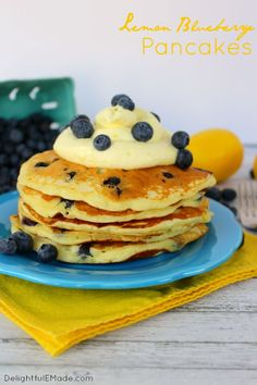 The fresh, delicious flavors of lemon and blueberry come together in these fluffy Lemon Blueberry Pancakes.  Topped with a delicious lemon cream cheese whipped topping, and fresh blueberries, these make for an amazing breakfast or brunch! #Breakfast #Lemonblueberry
