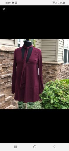 Beautiful top to add to your work wardrobe. A gorgeous burgundy wine color and lined with a red for contrast. Just perfect for autumn with cream pants. Cream Pants, Burgundy Wine, Work Wardrobe, Suit Jacket, Tunic, Blazer, Suits, Beautiful, Color