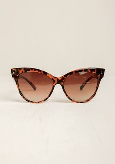 Created with a classic cat eye frame, these opaque faux tortoise shell glasses are complete with UV protectant ombre lenses to add a lady-like touch to any outfit. By A.J. Morgan 5.5