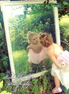 playing peekaboo with herself in the mirror. Enchanted baby portraits by Amber Huston