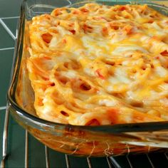 Baked Spaghetti  Directions  1.  Preheat oven to 350˚.      2. Cook noodles according to package instructions, stopping a minute or two before al dente.      3. Drain the noodles and mix with the spaghetti sauce and a cup of cheese. Place into a 9×13 baking dish and top with the remaining cup of cheese.      4. Bake for 20 minutes, or until cheese is golden and bubbly.